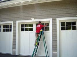 Cleaning garage door windows