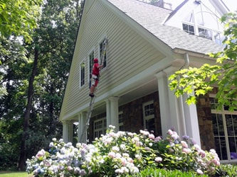 Cleaning exterior of residence