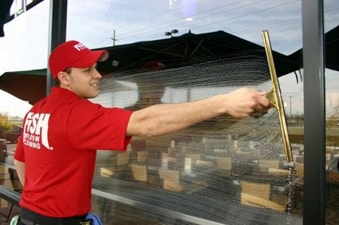 Exterior window cleaning with a squeegee
