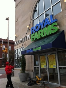 Cleaning exterior of Royal Farms