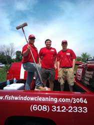 Fish Window Cleaning crew in the back of the FISH truck
