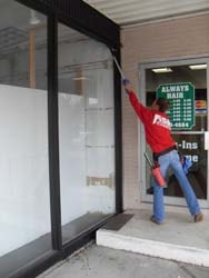 Cleaning windows with a pole