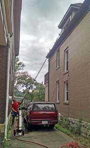 Utilizing A Water-Fed Pole For Hard-To-Reach Windows