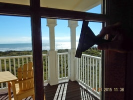 View of the Ocean Through Windows Being Cleaned