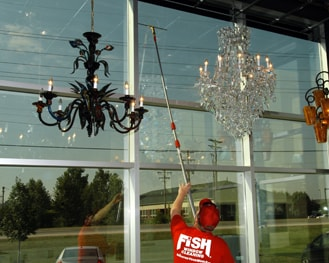 Cleaning commercial windows around chandeliers
