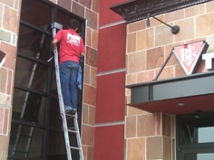 FISH Window Cleaner Using Ladder to Clean Exterior Windows