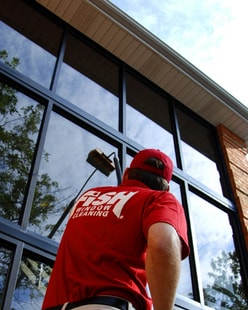 cleaning exterior commercial windows with a water-fed pole